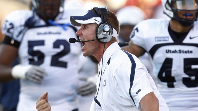 FILE - In this Sept. 4, 2010, file photo, Utah State head coach Gary Andersen shouts to his team during the second quarter of an NCAA college football game against Oklahoma in Norman, Okla. Wisconsin will hire Utah State's Gary Andersen as head football coach to replace Bret Bielema, according to multiple media reports. (AP Photo/Sue Ogrocki, File0