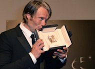 "Danish heart-throb Mads Mikkelsen, pictured here, clinched the best actor prize at Cannes on Sunday for his role in Thomas Vinterberg's taut psychological thriller ""The Hunt"". Italian jury head Nanni Moretti and his eight-strong panel handed the prestigious award to Mikkelsen for his turn as a man who watches his life unravel after he is falsely accused of molesting a child"