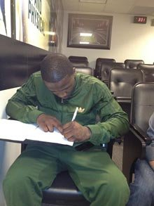 Phillip Thomas signs a contract to play for Philadelphia. (Eagles PR)