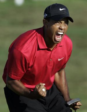 FILE - In this June 15, 2008, file photo, Tiger Woods reacts after sinking a birdie putt on the 18th green forcing a playoff against Rocco Mediate during the fourth round of the US Open championship at Torrey Pines Golf Course in San Diego. To try to gauge what kind of year Woods can expect, pay no attention to a missed cut in the Middle East. The better measure is Torrey Pines. It's one of five golf courses that account for more than 40 percent of his PGA Tour wins. (AP Photo/Lenny Ignelzi, File)