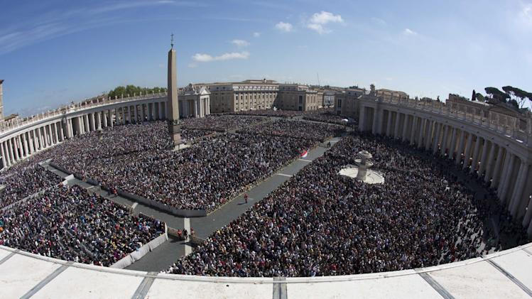 In this photo taken with a fisheye lens, a large crowd is seen in St. Peter's Square from the Bernini colonnade towards Via della Conciliazione avenue, top, during Pope Francis' Easter Mass, at the the Vatican, Sunday, April 20, 2014. Even before Mass began, a crowd of more than 100,000 was overflowing from the cobblestoned square, and many more Romans, tourists and pilgrims were still streaming in for the pontiff's tradition Easter greeting at noon (10:00 GMT). At left is the Apostolic Palace. (AP Photo/Alessandra Tarantino)
