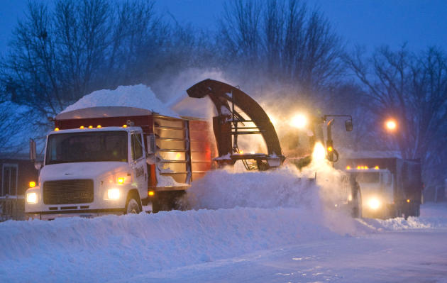 Snow clearing crews in Pine Island, Minn were out early trying to clear roads before morning commuters headed to work on Thursday, Dec. 20, 2012. The first major snowstorm of the season began its slow