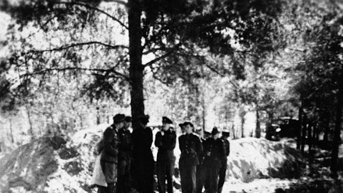 FILE - This Feb. 4, 1952, photo, shows a view of a partially emptied mass grave in the Katyn forest where a massacre of some 10,000 Polish prisoners of war took place in May 1943, near Smolensk, Russia.  Col. John H. van Vliet is shown in the group at the edge of the trench, and van Vliet is convinced that the Russians, not the Germans, were responsible for the massacre. The Obama administration is opposing a Jewish group's bid to levy civil fines against Russia for failing to obey a court order to return its historic books and documents — a dispute which has halted the loan of Russian art works for exhibit in the United States. In a recent court filing, the Justice Department argued that judicial sanctions against Russia in this case would be contrary to U.S. foreign policy interests and inconsistent with U.S. law. The Jewish group, Chabad-Lubavitch of Brooklyn, N.Y., has already persuaded Chief Judge Royce Lamberth of the U.S. District Court here that it has a valid claim to the tens of thousands of religious books and manuscripts, some up to 500 years old, which record the group's core teachings and traditions.  (AP Photo)