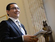 Romanian Prime Minister Victor Ponta leaves a press conference at the Romanian Parliament headquarters in Bucharest on July 18. Romania&#39;s ruling coalition filed a legal complaint on Thursday accusing 15 opposition leaders of defaming the ex-communist state that has been mired in political turmoil