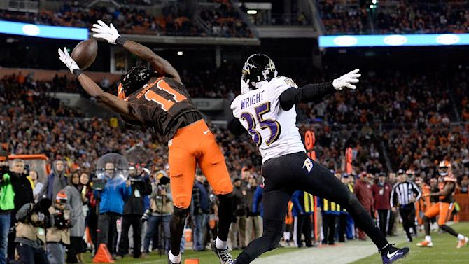 Cleveland Browns' Travis Benjamin misses a catch in front of Baltimore Ravens' Shareece Wright during their game at FirstEnergy Stadium on November 30, 2015