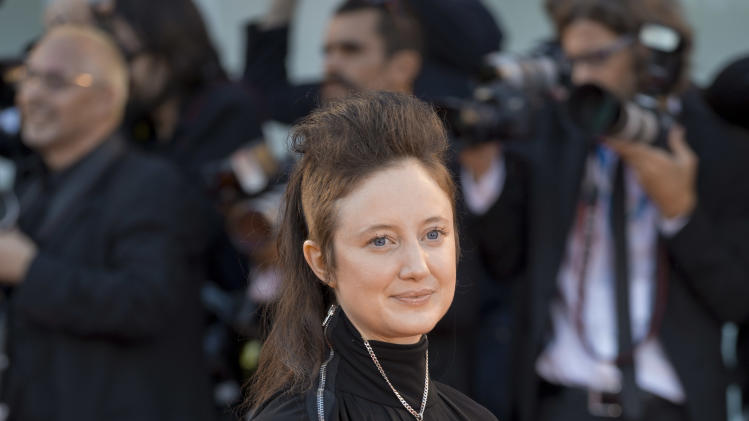 Actress Andrea Riseborough arrives for the screening of the movie Birdman opening the 71st edition of the Venice Film Festival in Venice, Italy, Wednesday, Aug. 27, 2014. (AP Photo/Andrew Medichini)