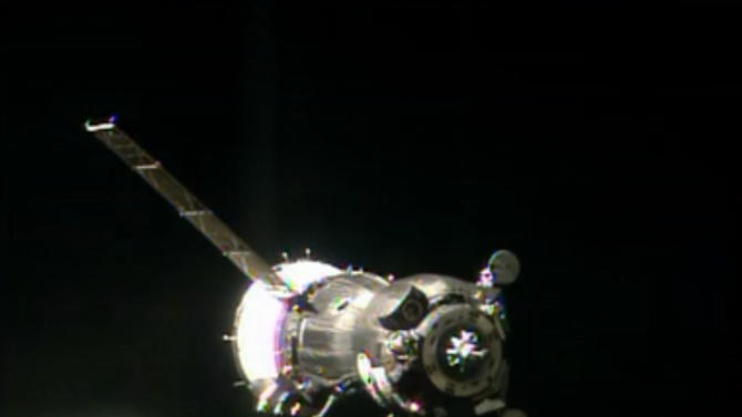 In this image taken from video provided by NASA, the Soyuz TMA-09M carrying three new Expedition 36 crew members approaches the International Space Station Wednesday, May 29, 2013. The cramped capsule carrying NASA's Karen Nyberg, Russian cosmonaut Fyodor Yurchikhin and Italy's Luca Parmitano orbited the Earth four times before docking with the space station. (AP Photo/NASA-TV)