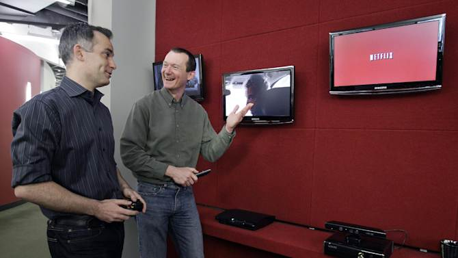 In this March 20, 2012, photo, Netflix executives John Ciancutti, left, and Neil Hunt talk at the Netflix headquarters in Los Gatos, Calif. A big part of Netflix's future rides on how much Ciancutti and about 150 engineers can improve the software that draws up lists of TV shows and movies that might appeal to each of the video-subscription service's 26 million customers. Netflix has spent 13 years learning viewers' disparate tastes so it can point out movies they might enjoy. (AP Photo/Paul Sakuma)