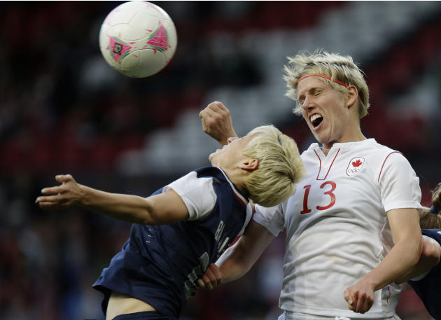 United States' Megan Rapinoe, left, heads for the ball against Canada's Sophie Schmidt, right, during their semifinal women's soccer match between the USA and Canada at the 2012 London Summer Olympics