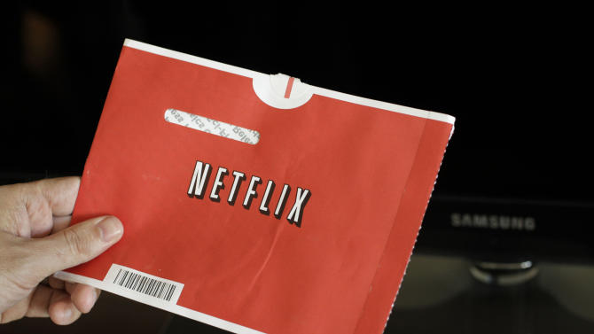 FILE - In this file photo made July 20, 2010, a Netflix customer holds up a movie in Palo Alto, Calif. Netflix Inc. announced Tuesday, July 12, 2011, it is launching new unlimited DVD-only plans in the U.S. at their lowest price ever- only $7.99 a month for the 1 DVD out at-a-time plan and $11.99 a month for the 2 DVDs out at-a-time plan.(AP Photo/Paul Sakuma, file)