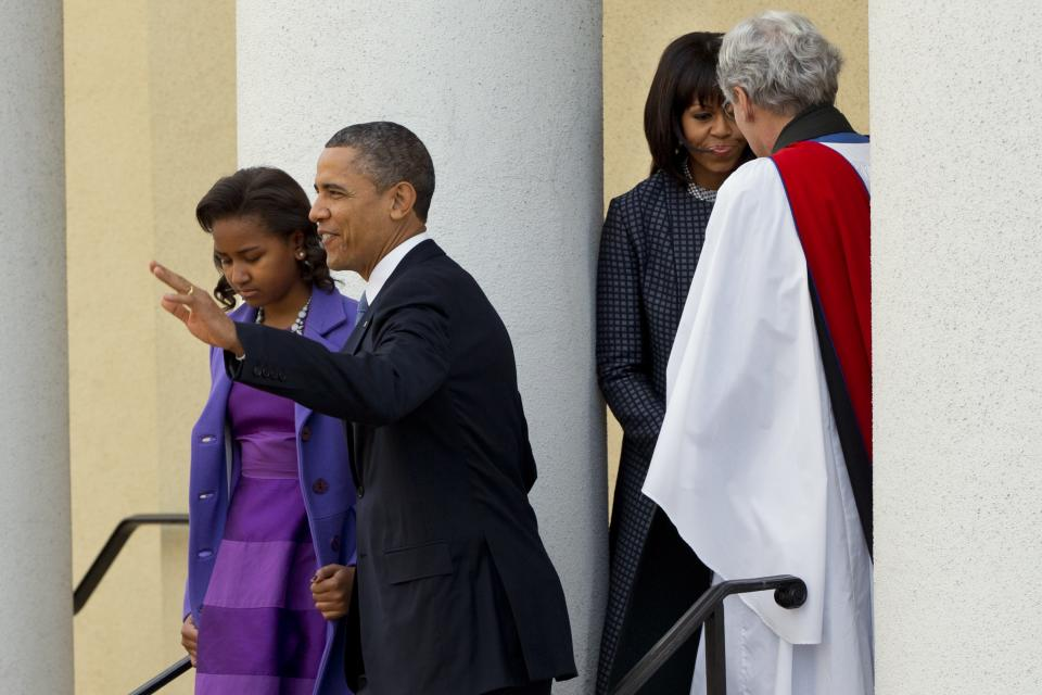 President Barack Obama, with daughter Sasha, waves as they leave St. John's Church in Washington, Monday, Jan. 21, 2013, followed by first lady Michelle Obama, talking with Rev. Luis Leon, after attending a church service during the 57th Presidential Inauguration. (AP Photo/Jacquelyn Martin)
