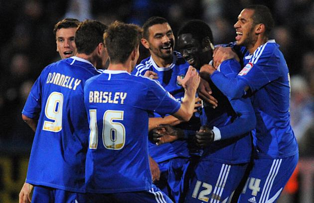 Macclesfield Town's Guinean Midfielder Arnaud Mendy (2R) Celebrates On January 7 2012   RESTRICTED TO EDITORIAL USE. No AFP/Getty Images