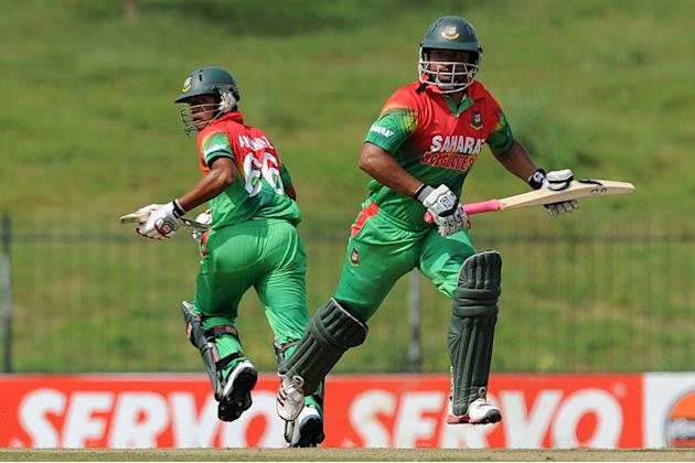 Bangladeshi cricketers Anamul Haque (L) and Tamim Iqbal run between the wickets during the opening one-day international (ODI) match between Sri Lanka and Bangladesh at The Suriyawewa Mahinda Rajapaks
