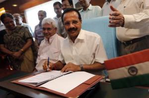 India's RM Gowda poses after giving the final touches to the railway budget for the 2014/15 fiscal year in New Delhi