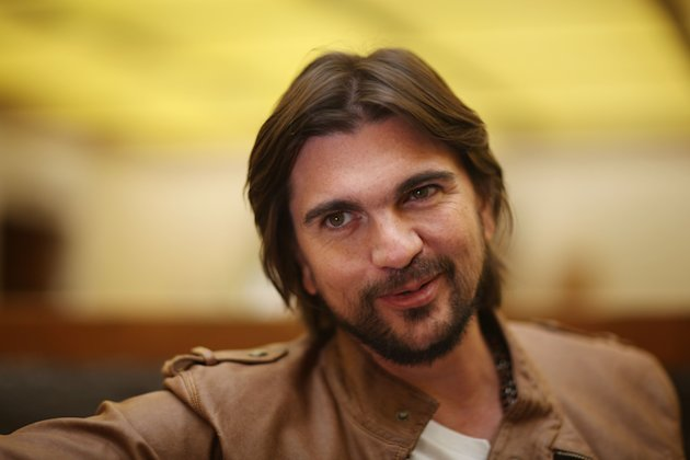 "FILE - In this May 4, 2012 file photo, Colombia's singer Juanes poses for photos during an interview in Mexico City. The Colombian singer announced Thursday that his first memoir will be released April 2 in English and Spanish. Its titles are ""Chasing the Sun"" and ""Persiguiendo el sol,"" and they'll be released on Celebra, a division of Penguin Group. (AP Photo/Alexandre Meneghini, file)"