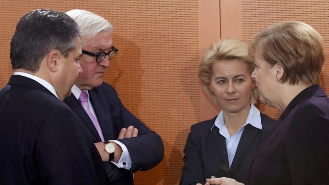 Germany's Economy Minister Gabriel, Foreign Minister Steinmeier,  Defence Minister Leyen and Chancellor Angela Merkel speak during the cabinet meeting at the Chancellery in Berlin