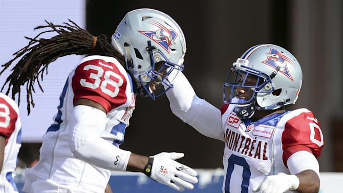 Montreal Alouettes' Ellis and Logan celebrate Logan's touchdown against the Calgary Stampeders during a CFL football game in Calgary