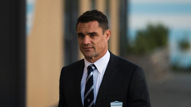 New Zealand fly-half Dan Carter arrives for a press conference at the Racing Metro 92 training centre after signing a three-year deal with the French rugby union team, on November 27, 2015