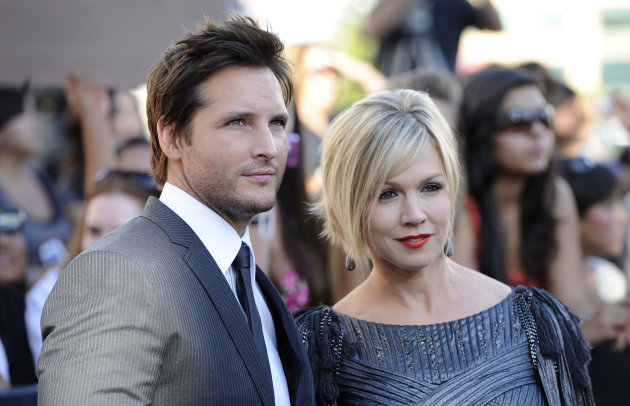 "FILE - In this June 24, 2010 file photo, actress Jennie Garth, right, and her husband actor Peter Facinelli arrive at the premiere of ""The Twilight Saga: Eclipse"" in Los Angeles. In a joint statement, the couple said they've decided to end their marriage. They have been married for 11 years and are parents to three daughters. (AP Photo/Chris Pizzello)"