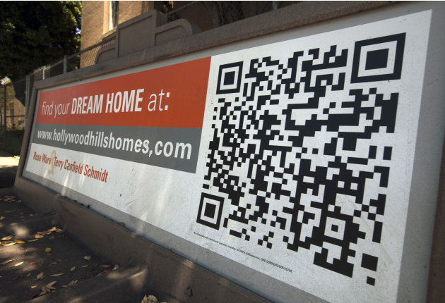 "In this Tuesday, July 17, 2012 photo, a Quick Response Code is used on Realtor ad offering ""dream homes"" in the Hollywood Hills area of Los Angeles. Americans bought more homes in July than in June an"