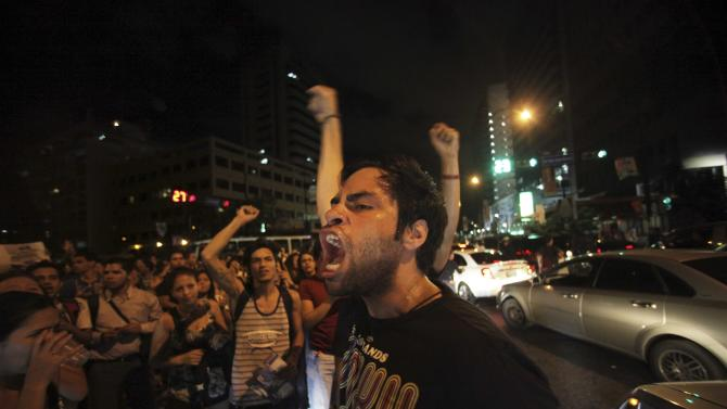 Supporters of former opposition presidential candidate Henrique Capriles demonstrate during a protest accusing Venezuela's President re-elect Hugo Chavez of electoral fraud in Caracas, Venezuela, Monday, Oct. 8, 2012. (AP Photo/Fernando Llano)