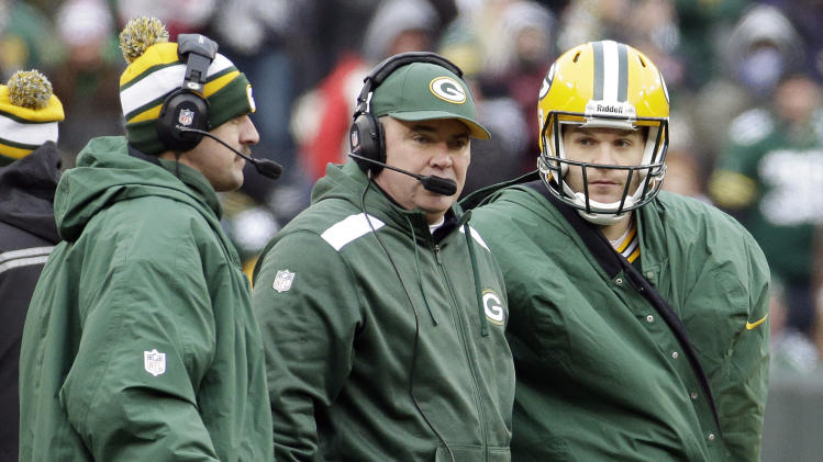 Green Bay Packers head coach Mike McCarthy and Aaron Rodgers, left, talk to quarterback Matt Flynn during the second half of an NFL football game against the Minnesota Vikings Sunday, Nov. 24, 2013, in Green Bay, Wis. The game ended in a tie, 26-26. (AP Photo/Morry Gash)
