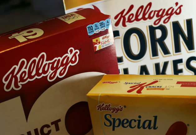 In this Wednesday, Oct. 31, 2012, photo, Kellogg's brand food products are photogrpahed in North Andover, Mass. Kellogg's appetite for salty snacks is helping fatten its profits. The world's biggest cereal maker, best known for its Frosted Flakes, Pop-Tarts and Eggo waffles, says its recent acquisition of Pringles chips boosted its net income in the third quarter. Kellogg Co., based in Battle Creek, Mich., bought the brand earlier this year in hopes of becoming a global player in the salty snacks market. (AP Photo/Elise Amendola)