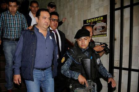 Guatemala president's brother, son held on suspicion of fraud