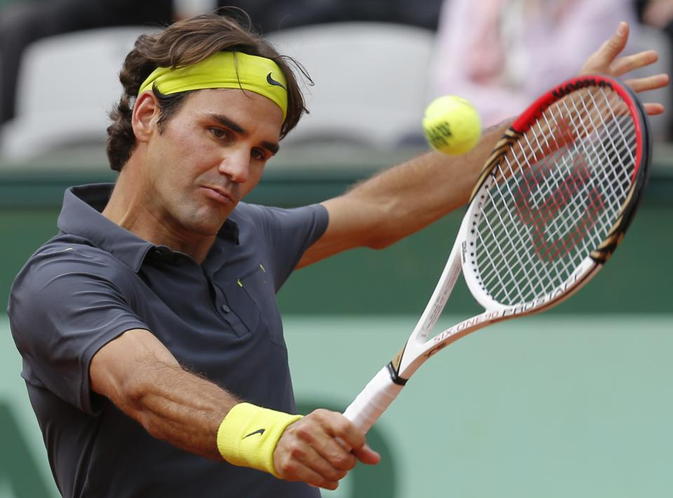 Roger Federer of Switzerland returns in his quarter final match against Juan Martin del Potro of Argentina at the French Open tennis tournament in Roland Garros stadium in Paris, Tuesday June 5, 2012. (AP Photo/Christophe Ena)