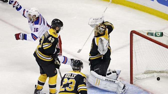 New York Rangers center Derick Brassard (16) celebrates after teammate Ryan McDonagh scored against Boston Bruins goalie Tuukka Rask, right, during the second period in Game 1 of an NHL hockey playoffs Eastern Conference semifinal game in Boston, Thursday, May 16, 2013. (AP Photo/Charles Krupa)