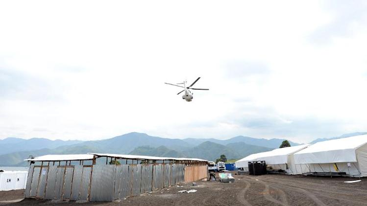 This photo taken on May 29, 2013, shows a United Nations peacekeeping mission helicopter flying over a UN basecamp in Goma