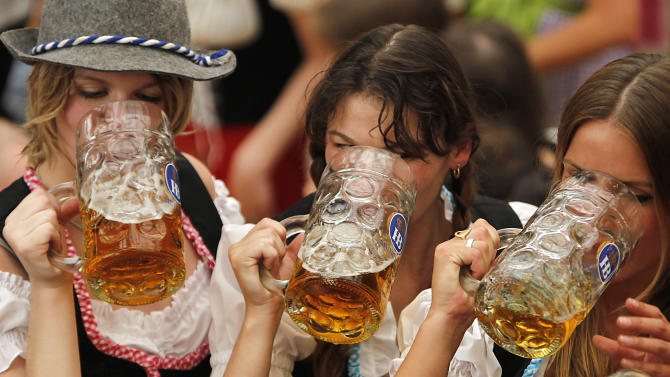 FILE - The Sept. 17, 2011 file photo shows young people drinking beer during the opening ceremony of the famous beer festival 'Oktoberfest' in Munich, southern Germany. Germans are emptying fewer beer steins these days. Consumption of the national beverage fell by 1.8 percent last year to the lowest level since West and East Germany reunified in 1990. The German government statistics agency reported Wednesday, Jan 30, 2013 that Germans drank 96.5 million hectoliters of beer last year. That's 2.55 billion gallons.  (AP Photo/Matthias Schrader)