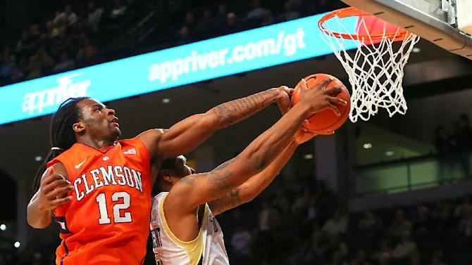 Clemson guard Rod Hall (12) blocks a shot by Georgia Tech guard Marcus Georges-Hunt during the first half of their NCAA college basketball game, Thursday, Feb. 14, 2013, in Atlanta. (AP Photo/Atlanta Journal-Constitution, Curtis Compton)  MARIETTA DAILY OUT; GWINNETT DAILY POST OUT; LOCAL TV OUT; WXIA-TV OUT; WGCL-TV OUT
