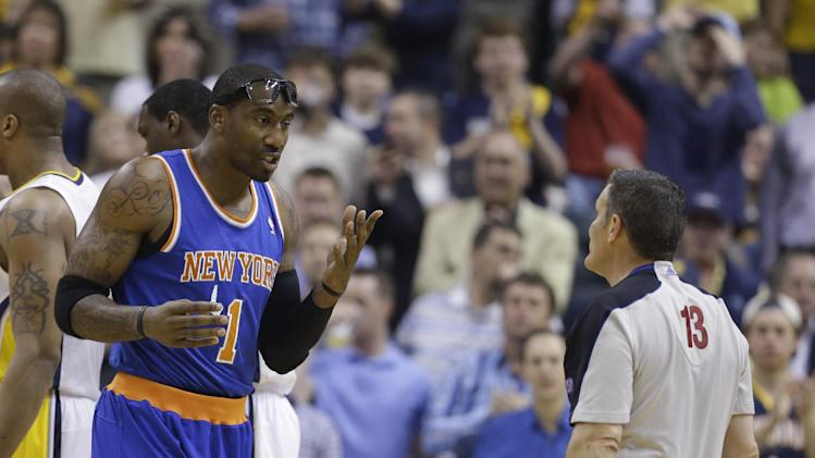 New York Knicks' Amare Stoudemire argues with referee Monty McCutchen after being called for a technical foul during the first half of Game 4 of an Eastern Conference semifinal NBA basketball playoff series against the Indiana Pacers on Tuesday, May 14, 2013, in Indianapolis. The Pacers won 93-82. (AP Photo/Darron Cummings)
