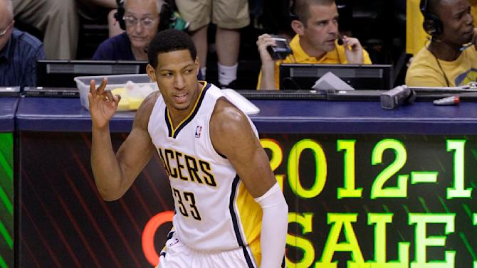 Indiana Pacers forward Danny Granger, top, signals after making a 3-pointer on an assist from shooting guard George Hill, bottom, during the second half of Game 3 against the Miami Heat in their NBA basketball Eastern Conference semifinal playoff series in Indianapolis, Thursday, May 17, 2012. (AP Photo/Michael Conroy)