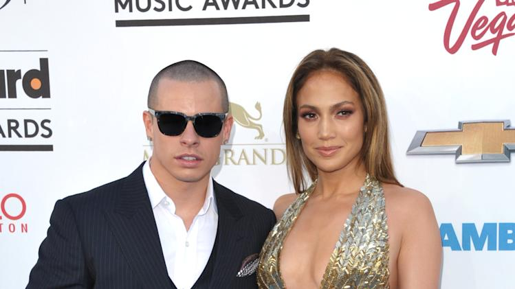 Casper Smart, left, and Jennifer Lopez arrive at the Billboard Music Awards at the MGM Grand Garden Arena on Sunday, May 19, 2013 in Las Vegas. (Photo by John Shearer/Invision/AP)