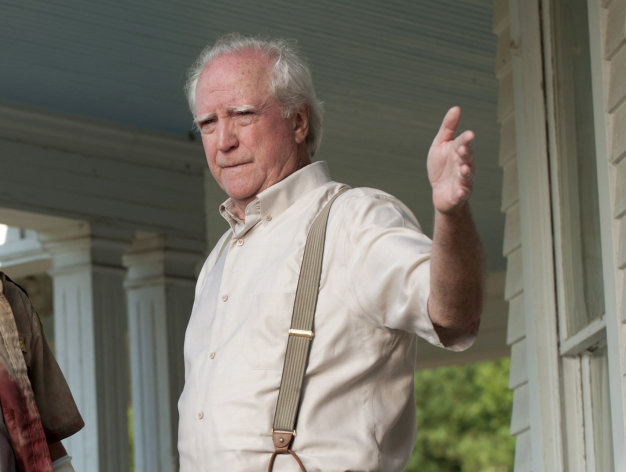 "In this image released by AMC, actor Scott Wilson appears in a scene from the second season of the AMC original series, ""The Walking Dead,"" in Senoia, Ga. Peachtree City police arrested 70-year-old Scott Wilson on Aug. 18, 2012 after someone called 911 to report a Chrysler PT Cruiser driving erratically. On the AMC drama, Wilson plays a farmer and recovering alcoholic who's part of a band of survivors after a zombie apocalypse. (AP Photo/AMC, Gene Page)"