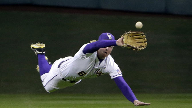 LSU center fielder Andrew Stevenson dives to catch a fly ball hit by Houston's Ashford Fulmer during the fourth inning of an NCAA college baseball game Friday, March 6, 2015, in Houston. (AP Photo/David J. Phillip)