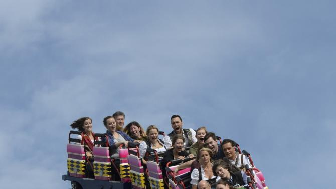 Visitors enjoy rollercoaster ride during opening day of  the 181st Oktoberfest in Munich
