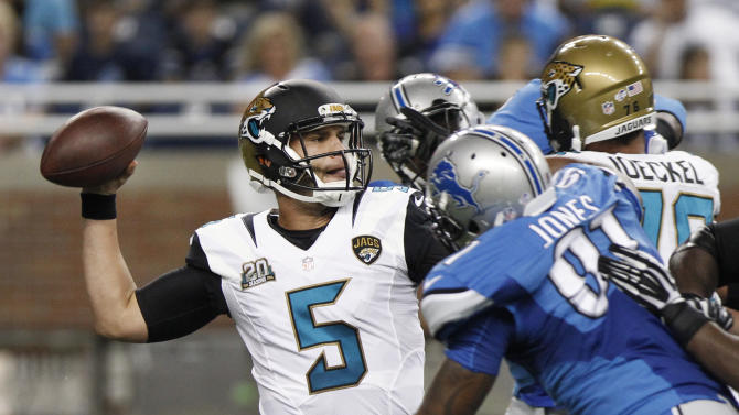 Jacksonville Jaguars quarterback Blake Bortles (5) throws against the Detroit Lions in the first half of a preseason NFL football game at Ford Field in Detroit, Friday, Aug. 22, 2014. (AP Photo/Duane Burleson)