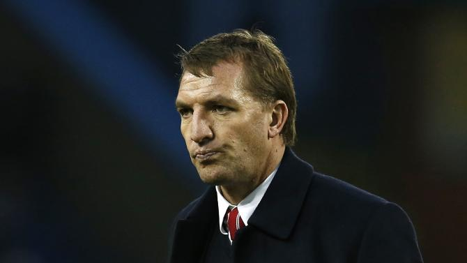 Liverpool manager Brendan Rodgers leaves the pitch at half time during their English Premier League soccer match against Burnley at Turf Moor in Burnley