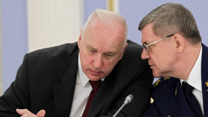 FILE In this Nov. 23, 2011 file photo, Alexander Bastrykin, head of the prosecutors' Investigative Committee, left, listens to Prosecutor General Yury Chaika, at a meeting in the Gorki residence outside Moscow.  Dmitry Muratov, the editor of Novaya Gazeta where Anna Politkovskaya had worked before her 2006 murder, said Wednesday, June 13, 2012, in an open letter to Investigative Committee chief Alexander Bastrykin that he should offer security guarantees to reporter Sergei Sokolov. Muratov said that Bastrykin was angered by a Novaya Gazeta article that accused him of failing to punish the perpetrators of a 2010 killing of 12 people, including four children, by a gang in southern Russia.  (AP Photo/RIA Novosti Kremlin, Mikhail Klimentyev, Presidential Press Service, file)