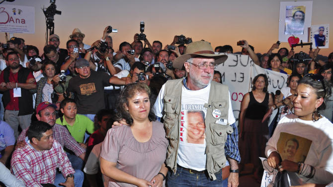 "Mexican poet Javier Sicilia, center right, stands with Luz Maria Davila during an event of the ""Caravan for Peace with Justice and Dignity"" in Ciudad Juarez, Mexico, Thursday, June 9, 2011. Sicilia, whose son was killed allegedly by gunmen belonging to a drug gang, has organized the peace caravan that will drive more than 1500 miles through cities and states in Mexico that have been most affected by drug-related violence. Davila lost two sons in 2010 when gunmen stormed a teenager birthday party in this violence plagued border city. (AP Photo"