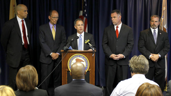 U.S. Attorney for the District of New Jersey Paul J. Fishman, center, speaks about a federal investigation of the Newark Police Department during a news conference Monday, May 9, 2011 in Newark, N.J. Also in attendance were, from left, Newark Mayor Cory Booker, Assistant US Attorney General for the Civil Rights Division Thomas Perez, Newark Police Director Garry McCarthy and Acting Newark Police Director Sam DeMaio. The Department of Justice on Monday announced an investigation into the policies and practices of the police department of New Jersey's largest city. The move comes months after the state American Civil Liberties Union complained of rampant misconduct and lax internal oversight at the Newark Police Department, although federal and city officials insisted that the ACLU's petition wasn't the main reason for the probe. (AP Photo/Julio Cortez)