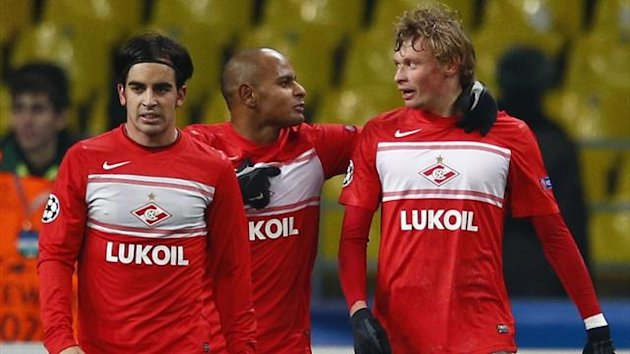 Spartak Moscow's Jose Manuel Jurado (L), Ari (C) and Evgeni Makeev (R) celebrate an own goal by Benfica's Jardel during their Champions League Group G match at Luzhniki stadium in Moscow