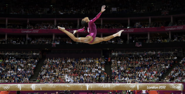 U.S. gymnast Gabrielle Douglas performs on the balance beam during the artistic gymnastics women&#39;s individual all-around competition at the 2012 Summer Olympics, Thursday, Aug. 2, 2012, in London. (AP Photo/Gregory Bull)