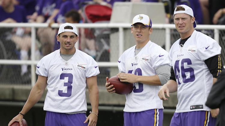 Minnesota Vikings kicker Blair Walsh, left, punter Jeff Locke, center, and long snapper Cullen Loeffler stand on the sidelines during an NFL football training camp, Saturday, July 26, 2014, in Mankato, Minn. (AP Photo/Charlie Neibergall)