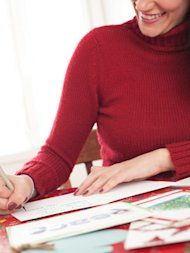 woman writing holiday cards