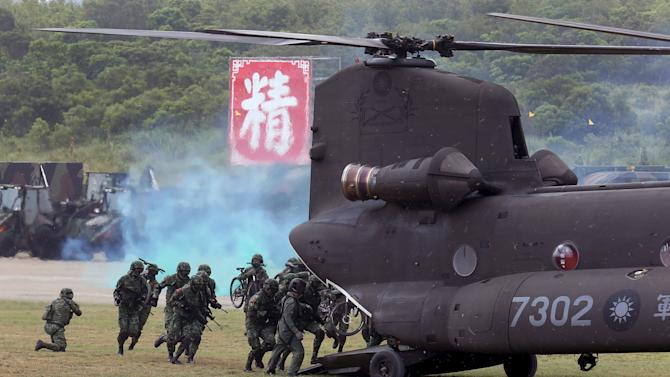 Military personnel enter a CH-47SD Chinook helicopter during the annual Han Kuang military exercise in an army base in Hsinchu