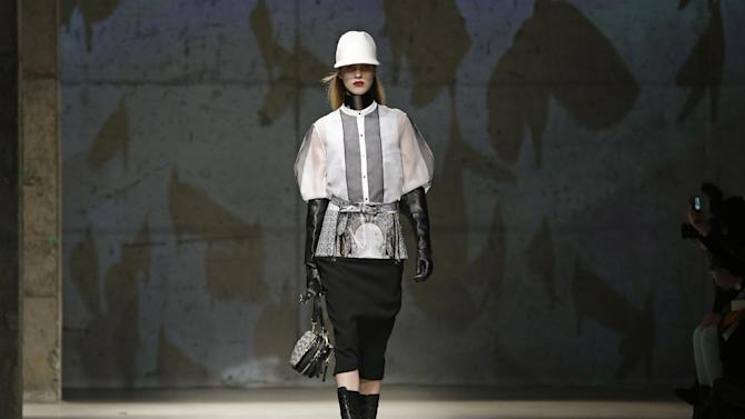 A model walks the runway during the presentation of the Kenneth Cole Fall 2013 fashion collection during Fashion Week in New York, Thursday, Feb. 7, 2013.  (AP Photo/Kathy Willens)